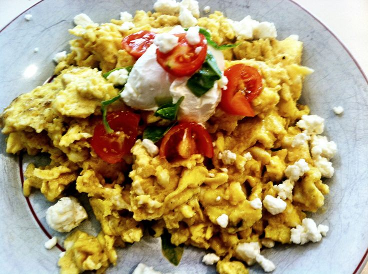 ... Garnish on eggs with chopped basil, chopped tomatoes and feta cheese