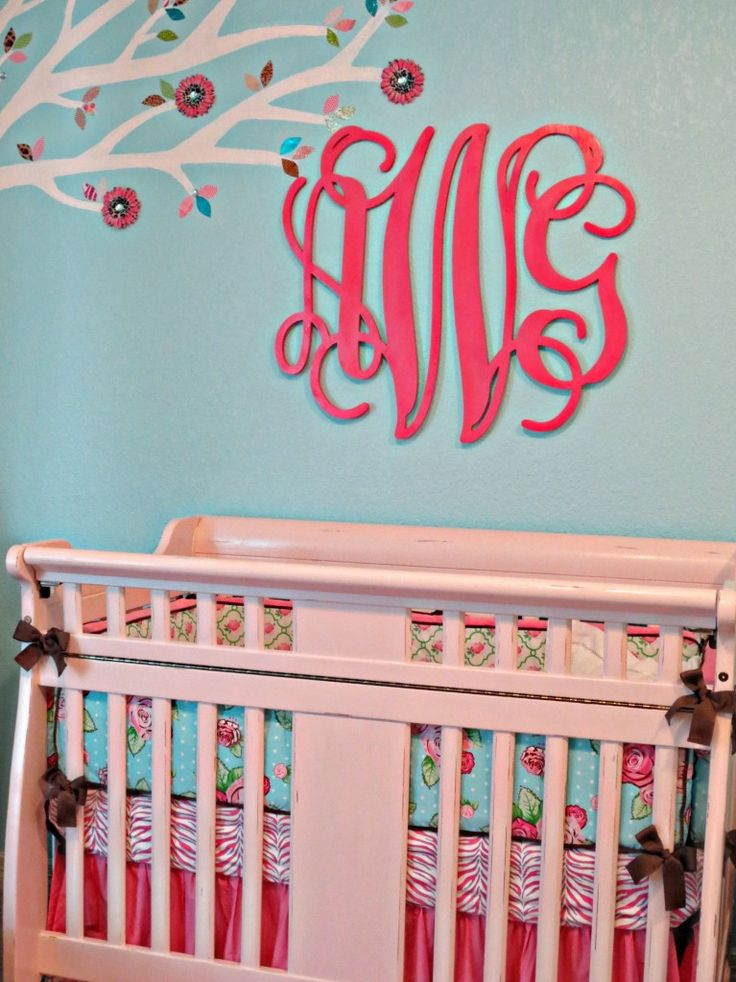 Aqua and pink is such an amazing color combo in the nursery!