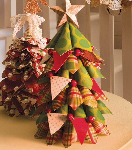 We love how @DCWV Inc. paper stacks were used to create these fun Christmas trees! #fabulouslyfestive