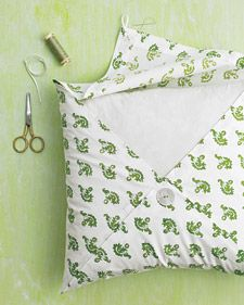 Turn fabric into pillows - tack 3 corners together with the button and 1 corner with elastic loop. no sewing!