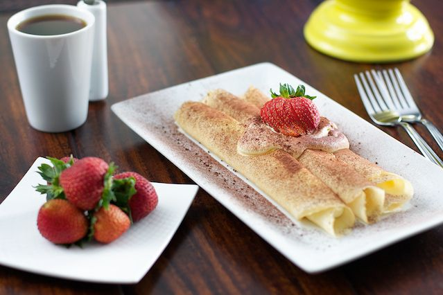 ... mascarpone cheese rolled in a crepe and sprinkled with cocoa powder