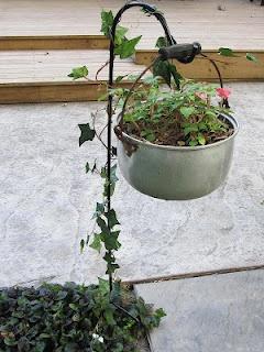 reuse an old pot as a hanging planter