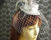 "Mini Top Hat Fascinator Hair Clip - ""TUXEDO"" - Black & White Feathers, White Hat, Silver Sequins, Black Veil. Bridal/ Victorian. $35.00, via Etsy."