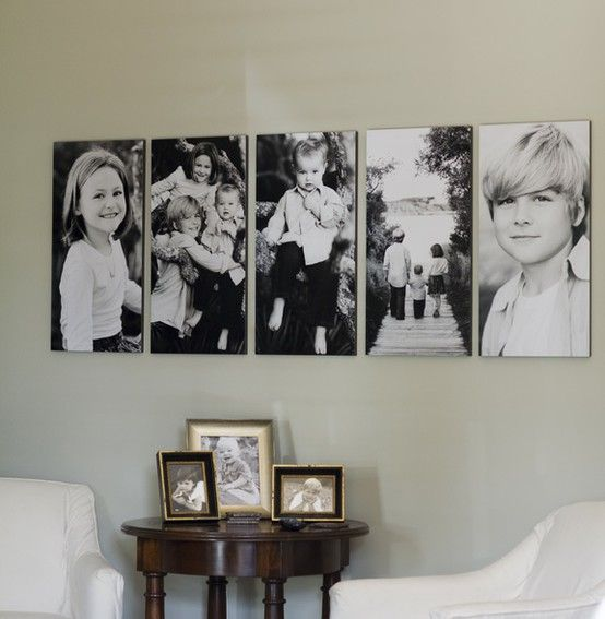 A Row of Family Portraits On Tall, Thin Canvases