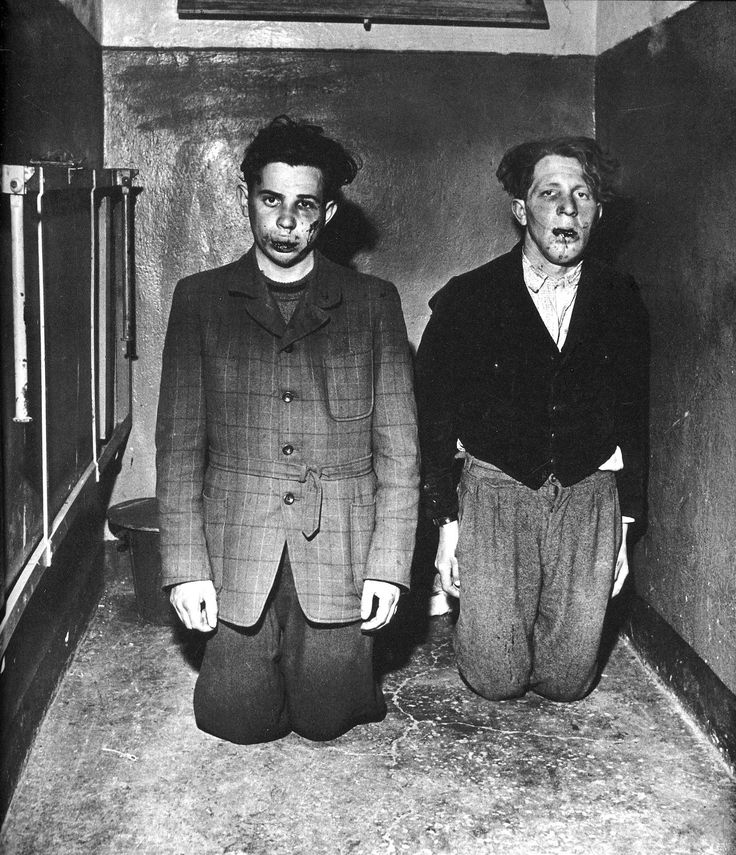 These are Buchenwald concentration camp guards who have gotten a beating from the prisoners upon liberation of camp by the Americans. The picture was taken in April 1945, by the U.S. military photographer Elizabeth Miller.