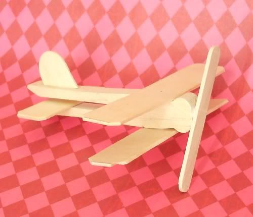 Wooden Airplane ornament made with flat clothespin and popsicle sticks = Jeff's xmas present hint