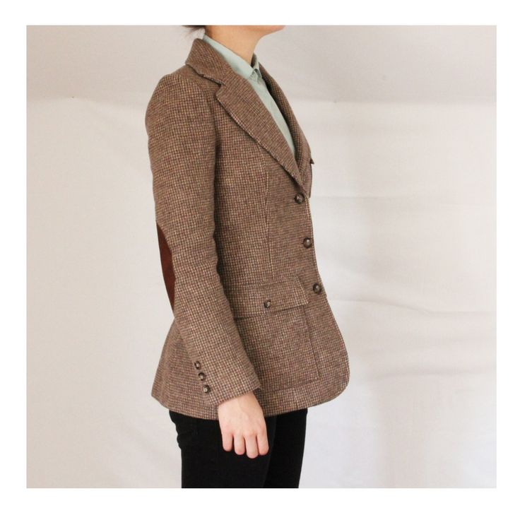 Some people like elbow patches on their jackets (not suits; normally sport coats, blazers or tweeds), much for the same reason some people like jeans that, uh, look like this: Utterly inexplicable for some, perfectly reasonable and fashionable for others.
