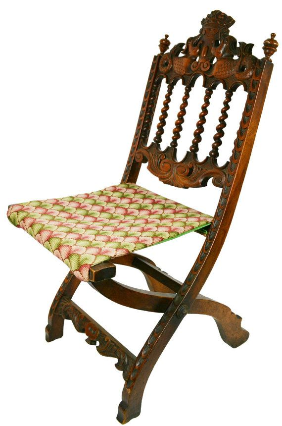 folding chair with embroidered seat carved ornamental