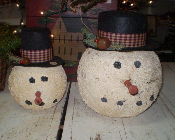 Snowman made from plastic Halloween bucket.