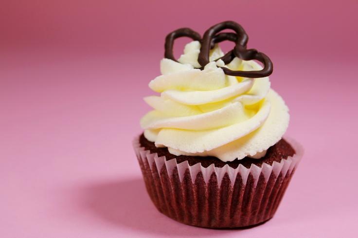 Pin to take a sainsburys caterpillar birthday cake in his hand luggage