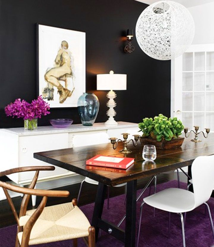 A black-walled room never looked so bright! Love the rich colors, natural elements, and modern pieces.
