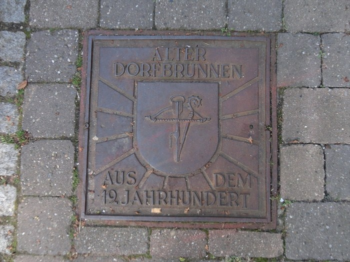 This is a beautiful unique manhole cover located at the Holzgasse in ...