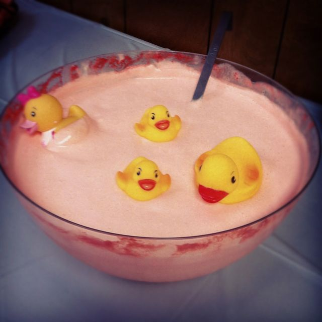 baby shower pink punch made with a tub of vanilla ice cream and 2