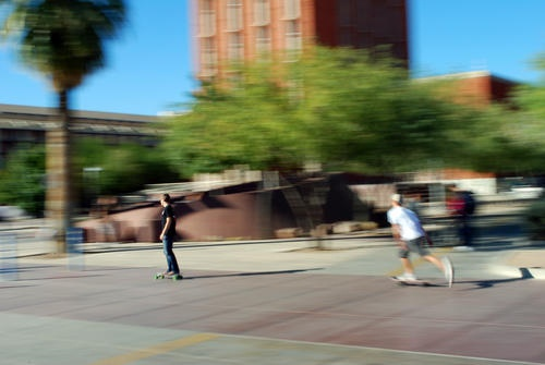 Skateboarders on campus