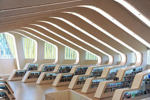 Helen and Hard architecture firm made this amazing looking library in Vennesla, Norway with prefabricated laminated timber boards.