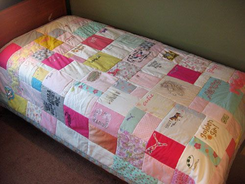 Quilts made of old baby clothes.  Such a great idea!  It's more in line with traditional quilts (that re-used worn-out clothing) than what a lot of quilters do these days.