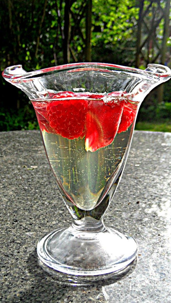 Elderflower cordial & prosecco jelly with raspberries and rose petals