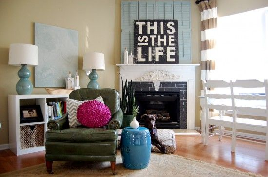Nester's living room.  Love the unexpected pop of pink.