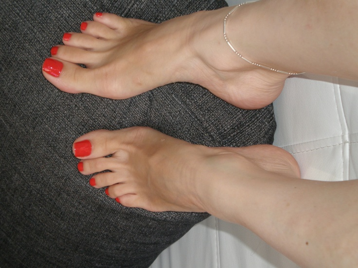 Painted and pretty feet red toes