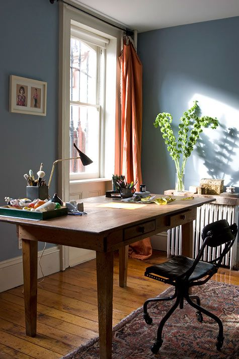 earthy blue walls and orange drapes