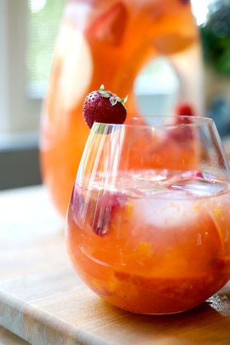 Sangria Bianca. White wine, peaches, nectarines, oranges, and strawberries.