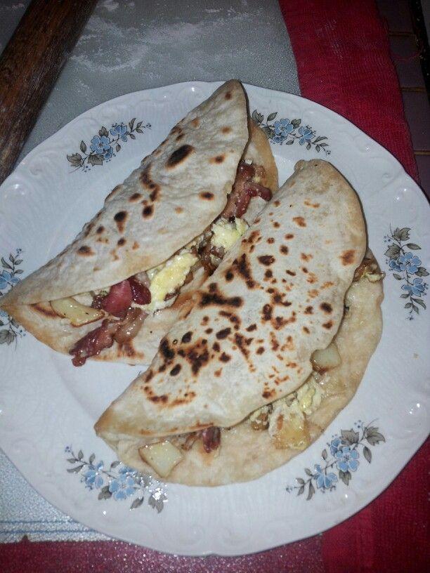 Potato, bacon and egg tacos with homemade flour tortillas.