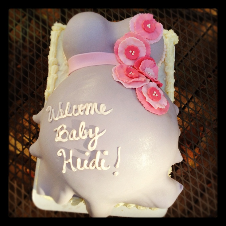 ... put foot kicking at bottom with toes. Pink and gray baby shower cake