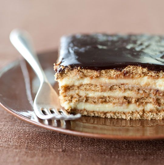 Marty No-Bake Boston Cream Pie Strata: Graham crackers layered with vanilla pudding, topped with fudge frosting and refrigerated overnight to meld.