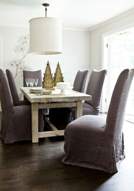 Delightful dining room by Melanie Turner Interiors. I like the wallpaper and the slouchy slipcovers on dining chairs!