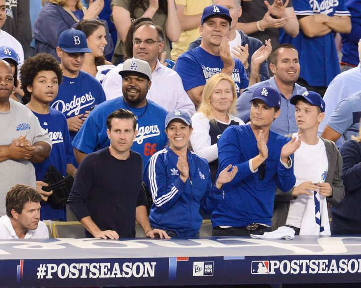 Ice Cube and actor Rob Lowe root, root, root for the home team at game three of the National League Championship Series between the Los Angeles Dodgers and St. Louis Cardinals on Oct. 14 in Los Angeles