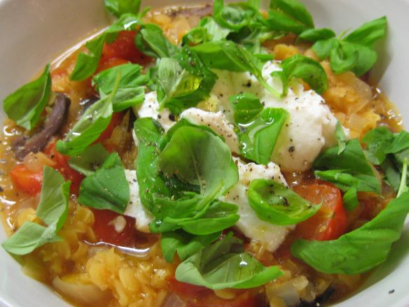 Fresh tomato and red lentil soup with basil, ricotta and black olives
