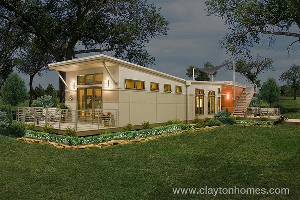 The Clayton i-house exterior features concrete fiber siding by James Hardie and durable corrugated steel siding. It also has a large outdoor living space which has been constructed with composite decking made from recycled materials. Another green  Spend Less Implementing  Green Solar Energy