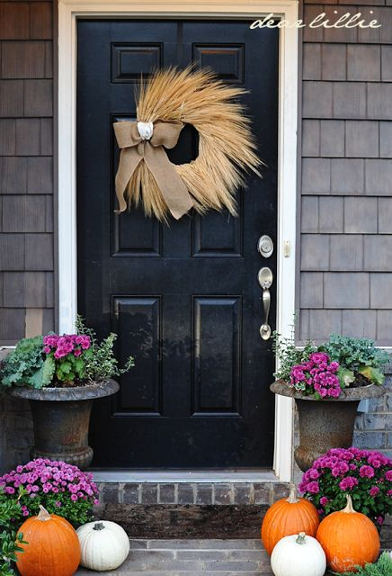 Love this front door decor for fall... especially the wheat wreath w/ burlap bow... simple but warm and welcoming