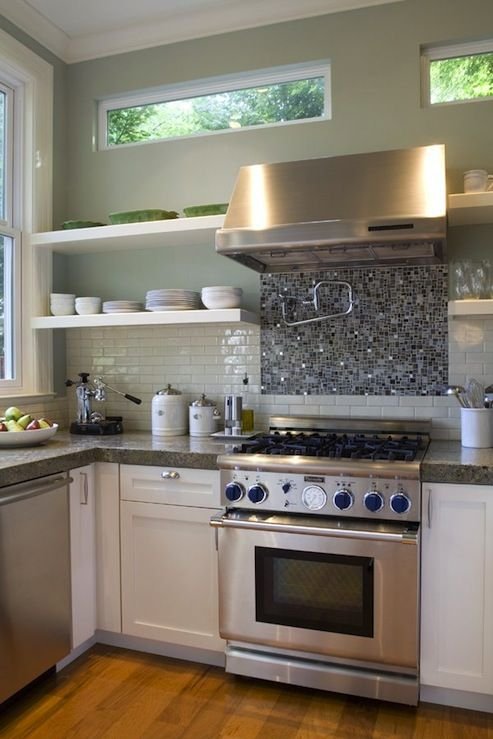 Like the idea of glass tiles behind stove up to hood and then subway