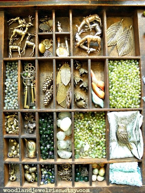 in my Woodland Jewelries studio, jewelry trinkets arranged in to antique box.