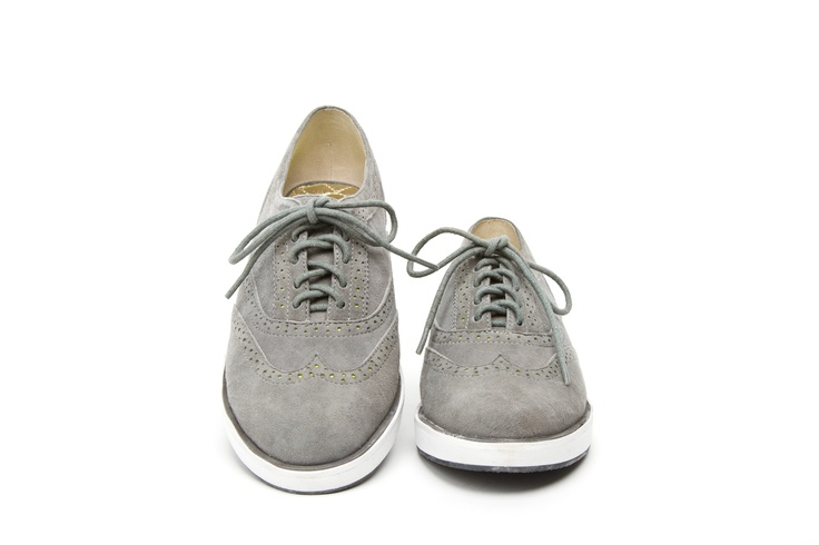 Women's wing tip suede lace up shoe