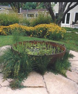 An old cauldron finds new life as a container water garden at the Lafayette, California,  whose garden was designed by Michael Thilgen .
