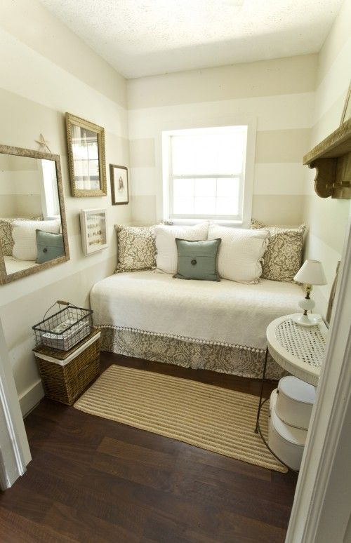 awesome use of space for a tiny bedroom. love the colors.