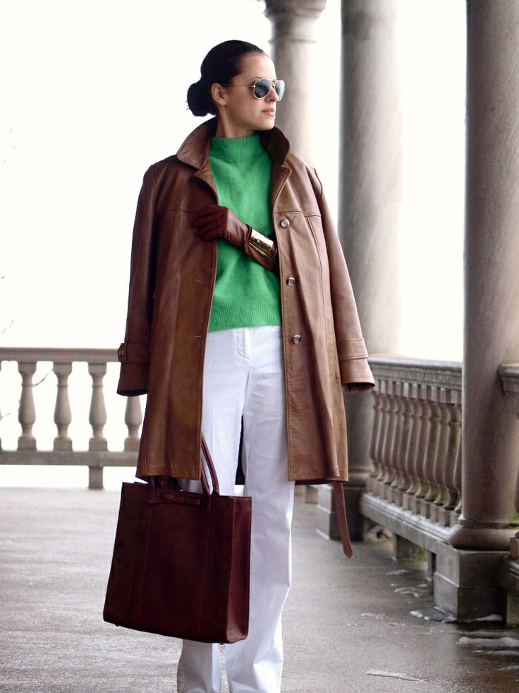 .white pants, kelly green top with camel coat