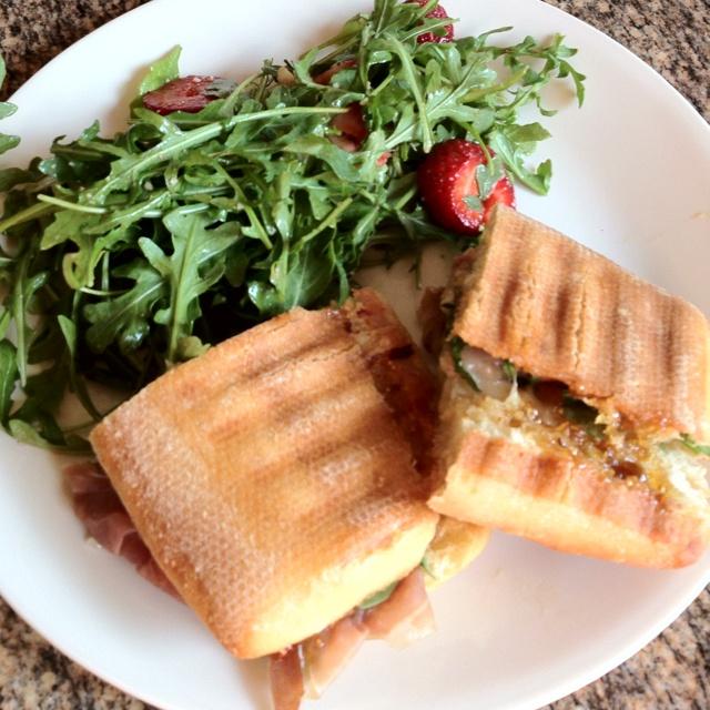 , Brie cheese, arugula and fig spread on a toasted ciabatta panini ...