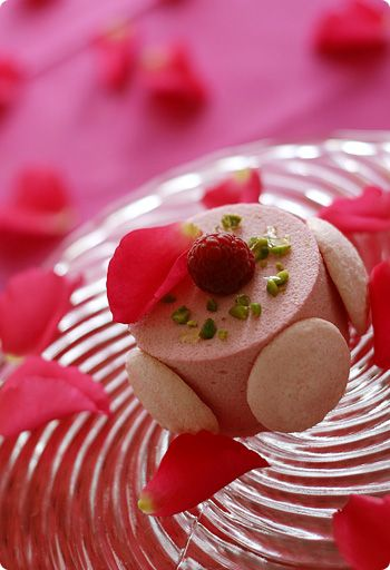 ... mousse inside covered with raspberry mousse and pink macarons