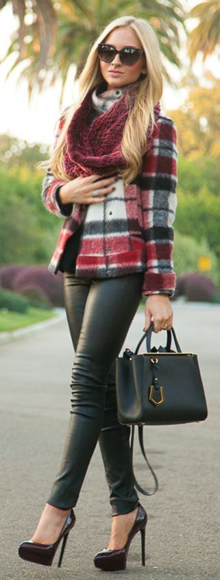 Beautiful plaid coat, leather pants and ultra high heels.
