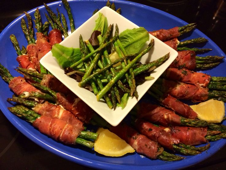 Prosciutto wrapped roasted asparagus with chive cream cheese, drizzled ...