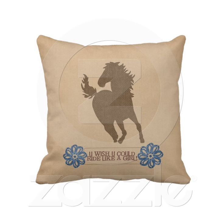 """Ride Like A Girl  Any of the girl or lady horse lovers will adore this pillow! A soft light brown with a deeper brown in the silhouette of a prancing horse and below it to blue flowers that appear to be made out of yarn and the words """"u wish u could ride like a girl"""" while the reverse side of the pillow is covered with the same soft brown and a repeating pattern of horse shoes in blue and horse silhouettes in deeper brown."""