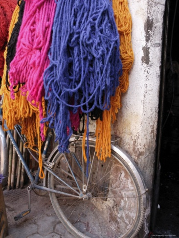 Brightly Dyed Wool Hanging Over Bicycle, Marrakech, Morrocco, North Africa, Africa