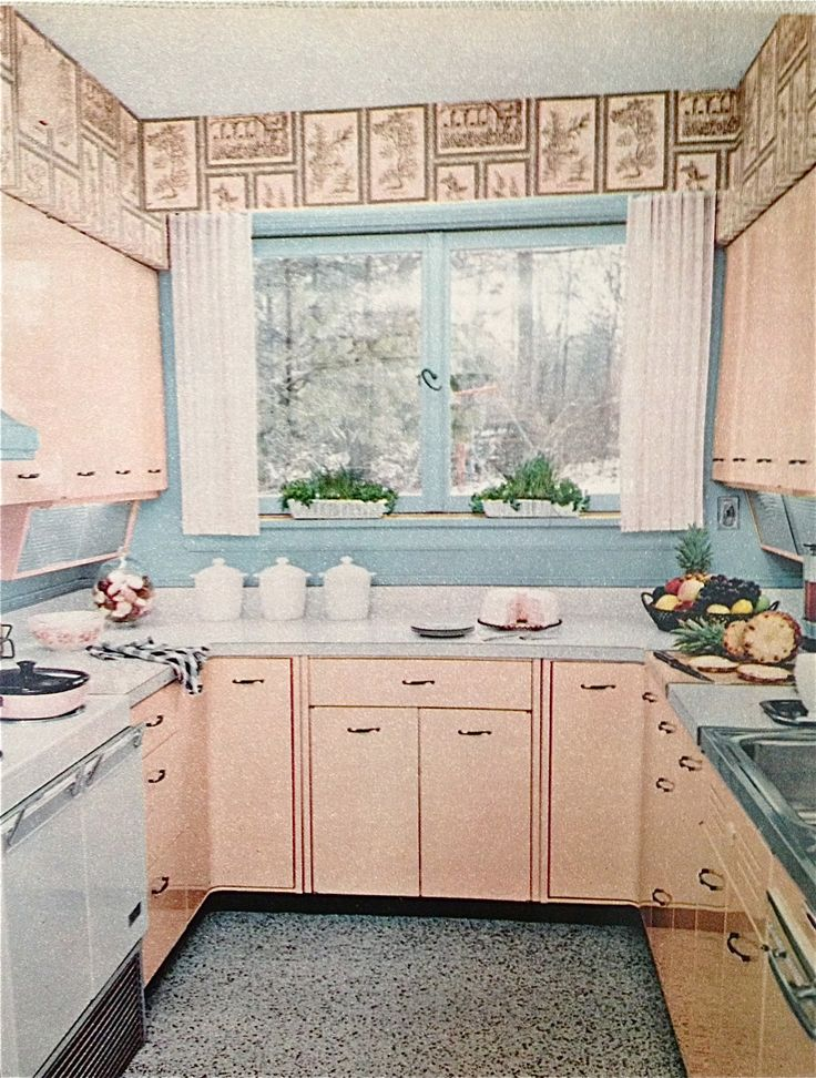1959 kitchen with lots of pink steel kitchen cabinets and white