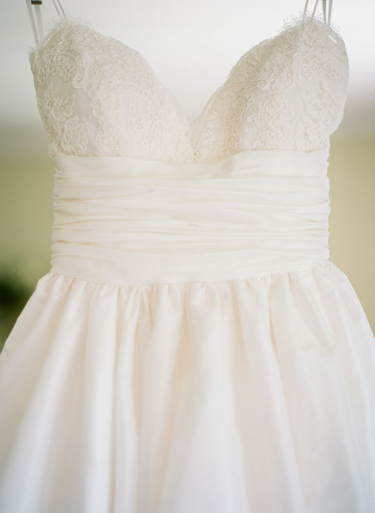 spaghetti strap wedding gown with ruched waist and flowy from the
