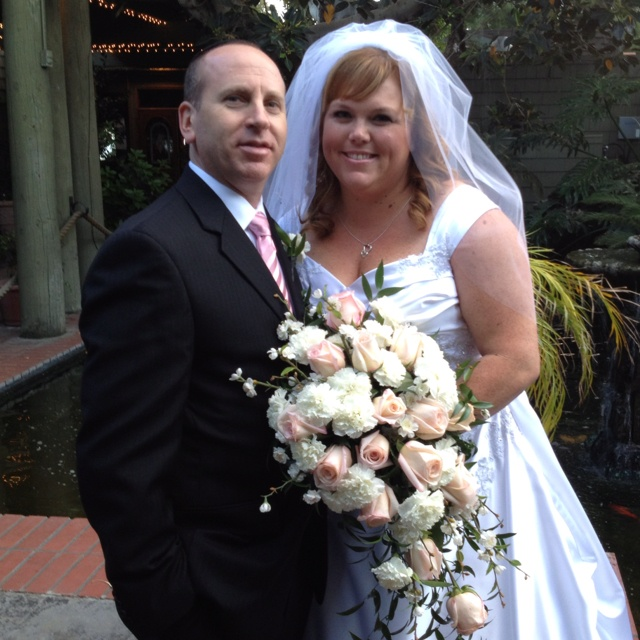 At the Odyssey in Granada hills in front of their fountains.   Just married by www.GreatOfficiants.com
