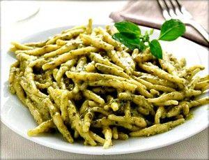 Trofie, hanmade ligurian pasta, with pesto (a delicious sause made ...
