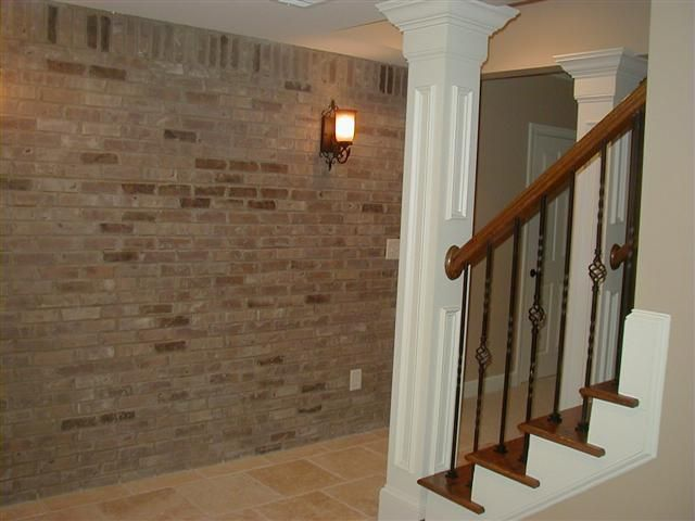 Basement Open Staircase W Brick Accent Wall Molding And